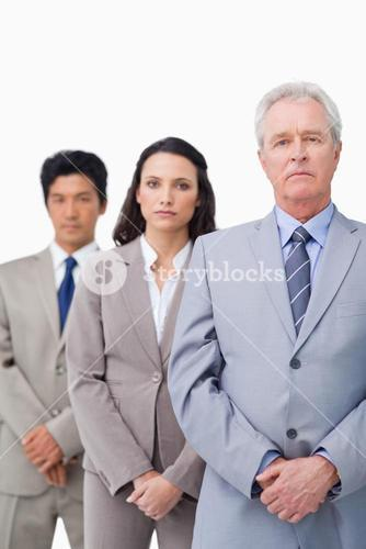 Mature salesman with his young employees