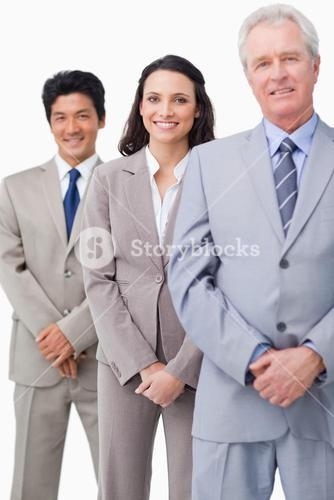Young employees standing behind their boss