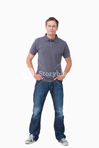 Young man with hands in his pockets