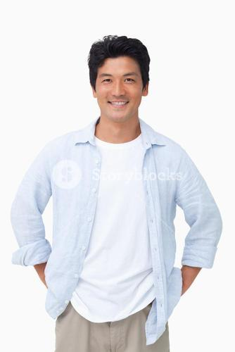 Smiling man with hands in his pockets