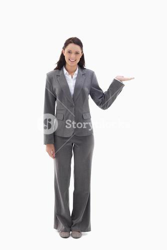 Smiling businesswoman with her hand held out