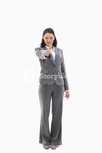 Businesswoman with her thumb up