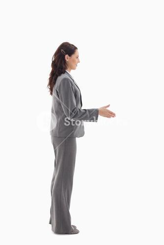 A businesswoman offering a shaking hands
