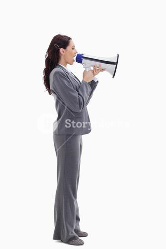 Businesswoman speaking loudly into a megaphone