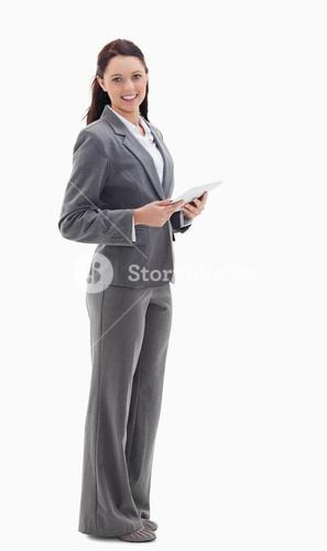 Businesswoman smiling while holding a ebook