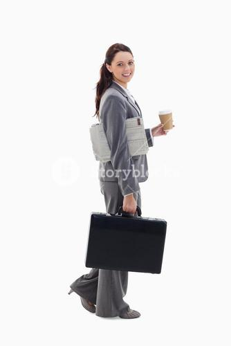 Smiling businesswoman is walking to work