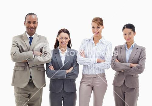 Close up of a business team smiling side by side and crossing their arms