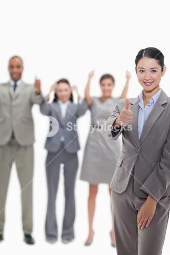 Approving business team with thumbsup