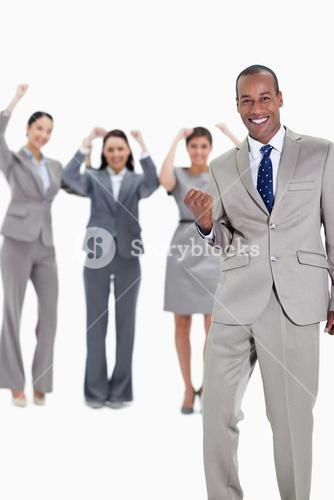Successful business team with a happy businessman in foreground