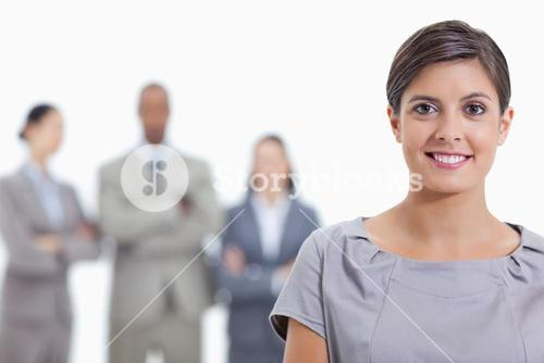 Big Close up of a businesswoman smiling and a team in background