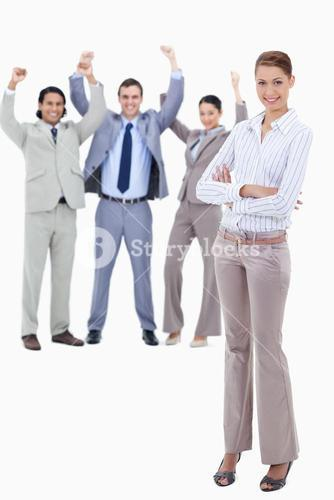 Secretary smiling and crossing her arms with very enthusiastic business people