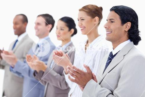 Close up of happy business people applauding