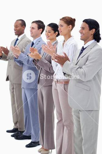Business people smiling and applauding