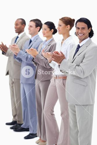 Business team smiling and applauding