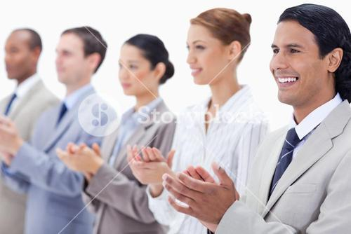 Close up of a business team applauding
