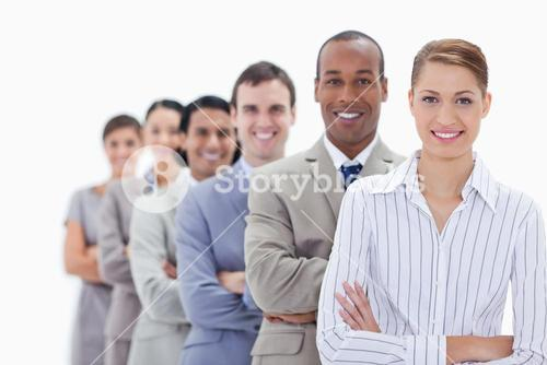 Close up of smiling people dressed in suits crossing their arms in a single line
