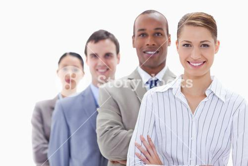 Close up of a business team smiling in a single line