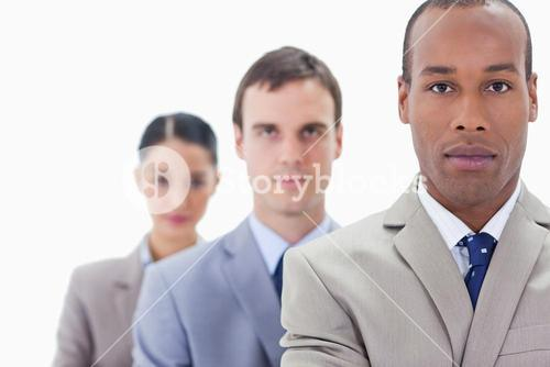 Big Close up of a business team in a single line looking straight