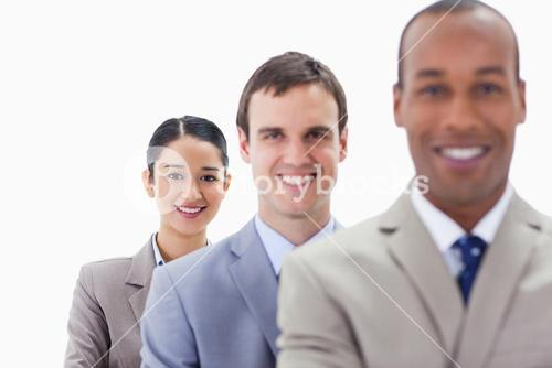 Big Close up of workmates smiling in a single line