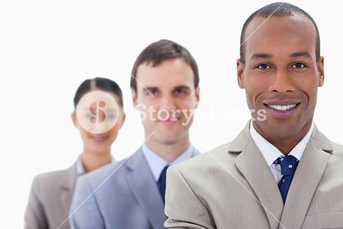 Big Close up of people dressed in suits smiling in a single line