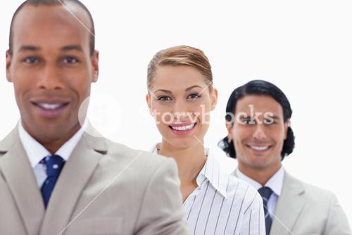 Big Close up of colleagues smiling in a single line