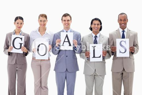 Business team holding the letters of GOALS
