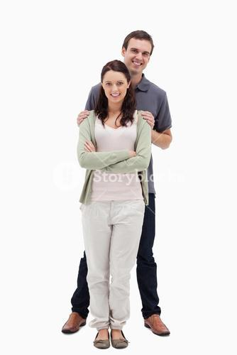 Man with his hands on womans shoulders