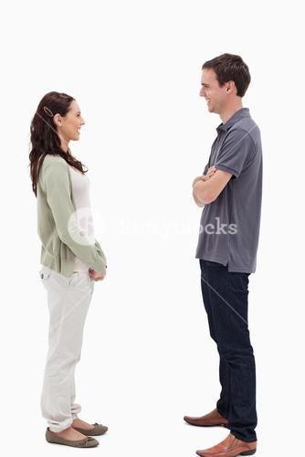 Couple standing face to face are laughing