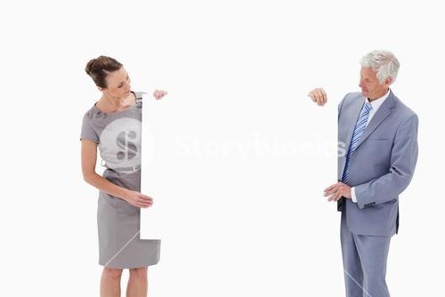 White hair businessman looking and holding a big white sign with a woman