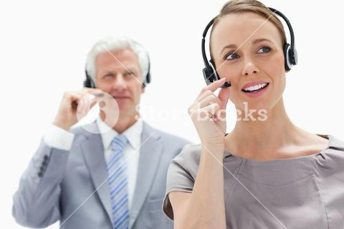 Woman wearing a headset with a businessman