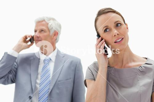 Business people talking on mobile phones