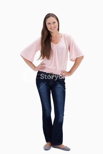 Woman smiling with her hands on her hips
