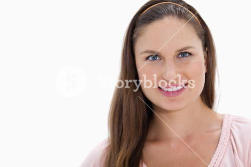 Young woman with brown hair is smiling