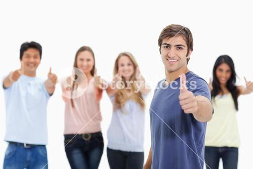 People smiling and approving with one of them in foreground