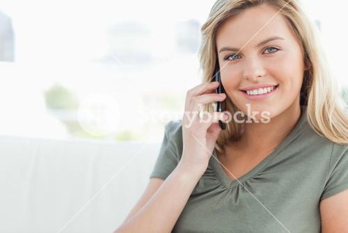 Woman smiling as she makes a phonecall