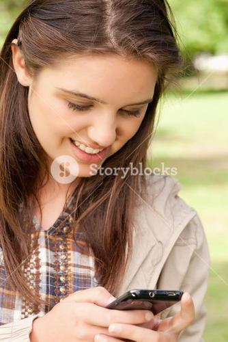 Close up of a cute teenager using a smartphone