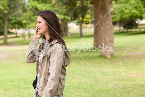 Side view of a teenager phoning