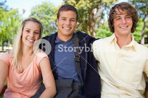 Portrait of three smiling students