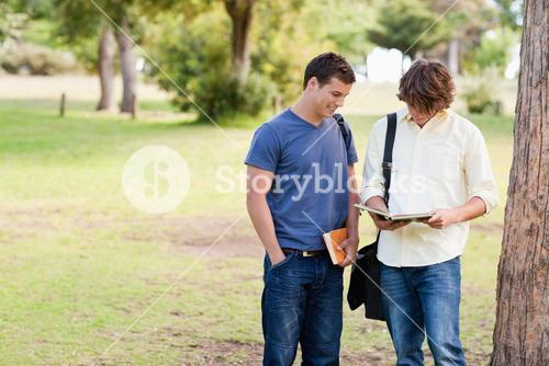 Two standing male students talking