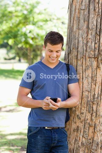 Muscled young man using a smartphone