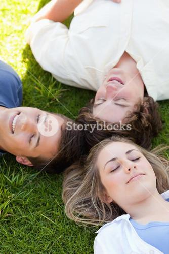 Three happy students resting together