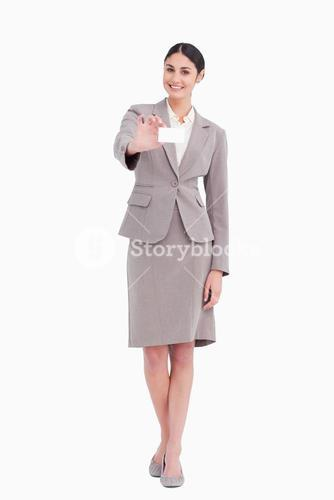 Smiling businesswoman with her blank businesscard
