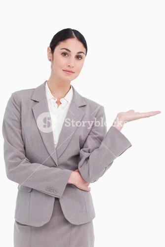 Young businesswoman with palm up