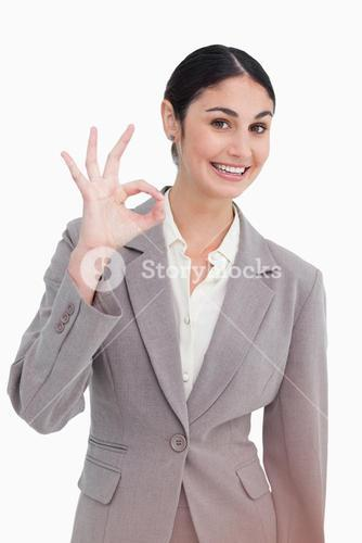 Young businesswoman giving approval