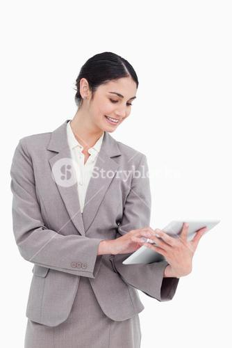 Smiling saleswoman using her tablet computer