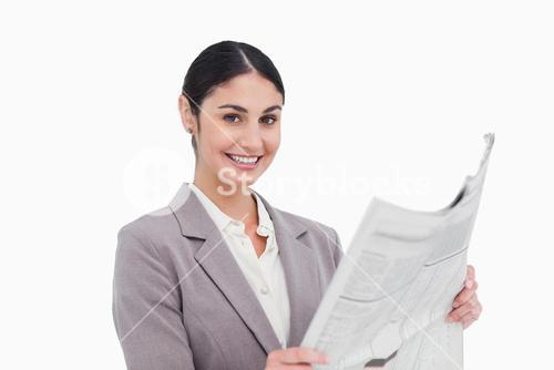 Smiling businesswoman with news paper