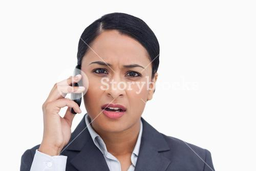 Close up of saleswoman getting bad news from caller