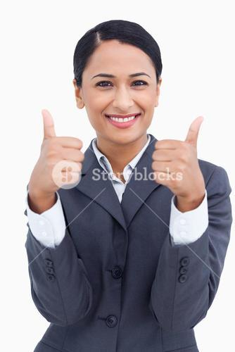 Close up of smiling saleswoman giving thumbs up