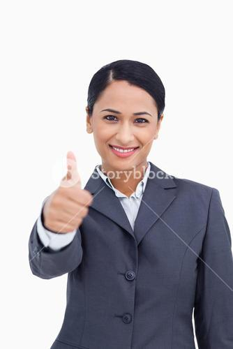 Close up of smiling saleswoman giving thumb up