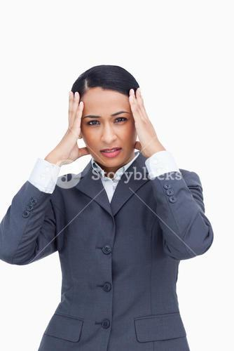 Close up of saleswoman experiencing a headache